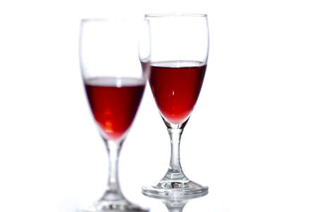 Two glasses of red wine on white background with reflection. Stock Photo - 8035734