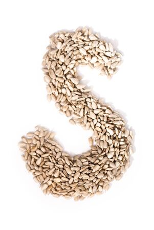 Alphabet S made of sunflower seeds. Stock Photo