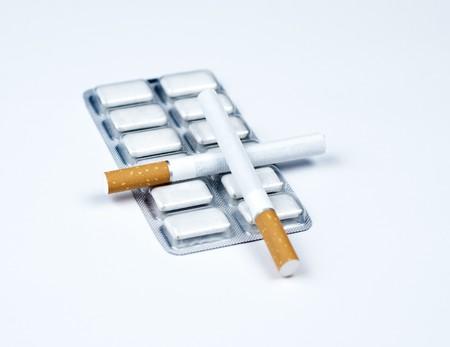 Nicotine gum and crossed tobacco. Stock Photo