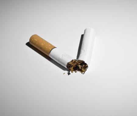 Conceptual photograph for quitting smoking. Broken cigarette.