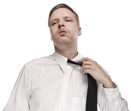 A tired white collar worker loosening his tie. Stock Photo - 8832116
