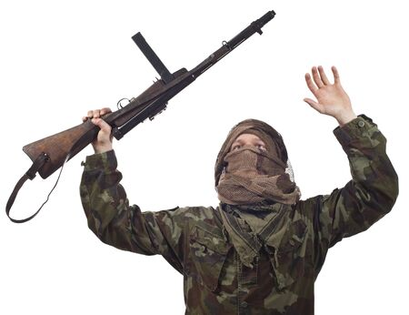 guerrilla warfare: A camouflaged guerrilla warrior screaming for war. Stock Photo