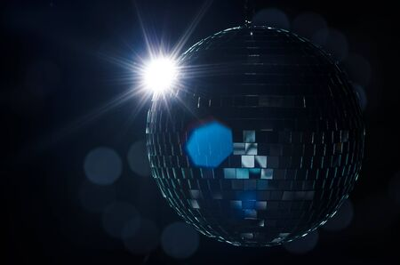 A disco ball with light flare and blurry lights on background  A nightlife image to be used as example on party fliers  Stock Photo - 17360206