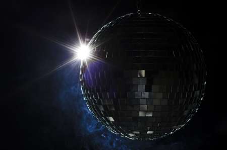 disco ball: A disco ball with light flare and smoke  A nightlife image to be used as example on party fliers  Stock Photo