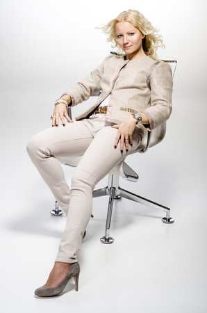 Casual and confident blond woman sitting on a office chair Stock Photo - 18572535