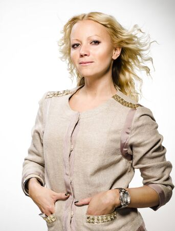 Upper body of confident pretty light haired woman  Hands in pocket  Stock Photo