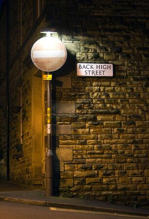 Back highstreet sign at night.