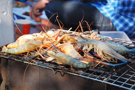 coal fish: Grilling fresh shrimps.