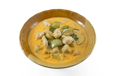 popular soup: Coconut curry in brown bowl white background