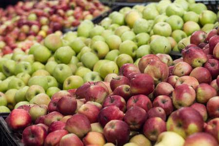 the shelf: apples on shelf in store