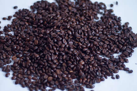 coffeetree: a lot of brown roasted arabica coffee beans as background