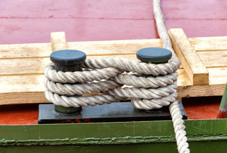 Mooring bollard with a fixed rope on the river ship