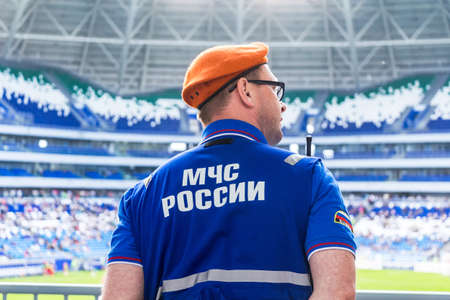 Samara, Russia - May 16, 2018: Russian emercom officer in uniform standing in the cordon against the background of the stadium. Text on russian: MOE RUSSIA Redactioneel