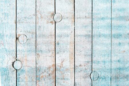White and blue faded old wood natural wood background. The view from the top. Natural rough planed texture of pine species. The surface of the table for shooting an even layer to lay. Copy space