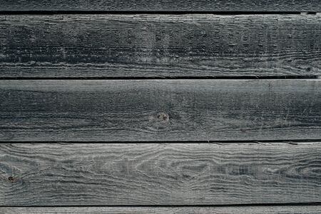 Old brown wood background made of gray dark natural wood in grunge style. The view from the top. Natural raw planed texture of coniferous pine. The surface of the table to shoot flat lay. Copy space