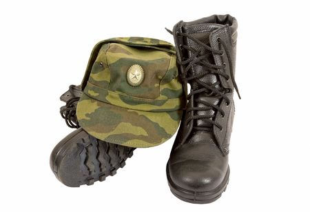 army boots: Army boots and cap Stock Photo
