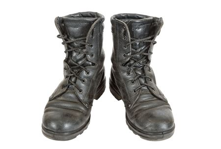 Old black army boots on white background photo