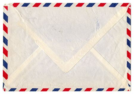 Vintage dirty airmail envelope on white background photo