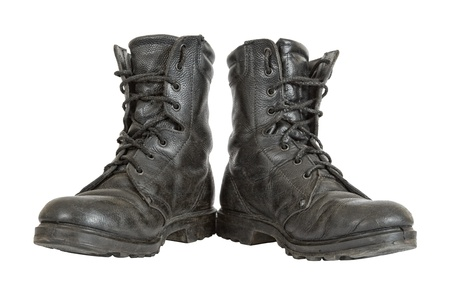 Old black army boots  isolated on white background photo