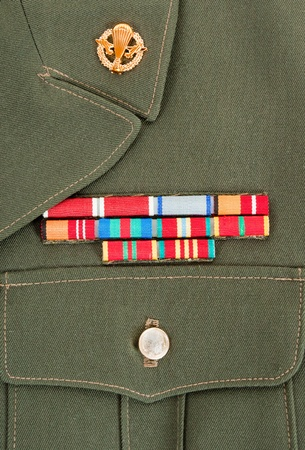 Military awards and decorations on green uniform photo