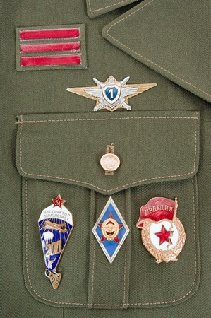 Russian military badges on the green uniform photo
