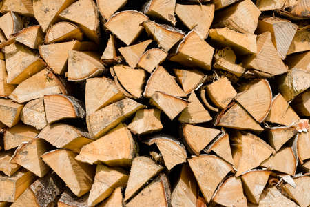 close-up of a pile of wooden logs for use as firewood Stock Photo