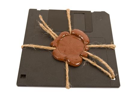 Top secret floppy disk on white background photo