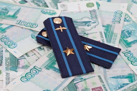 Shoulder strap of russian army on money  background photo