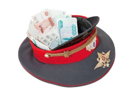 gorra polic�a: Police cap with money on white background Foto de archivo