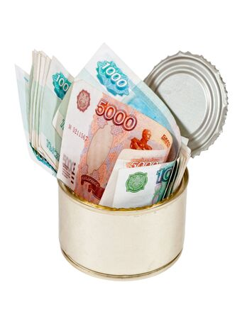 Russian roubles  bills  in  tin can over white background photo