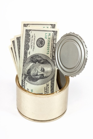 US dollars bills  in tin can over white background photo