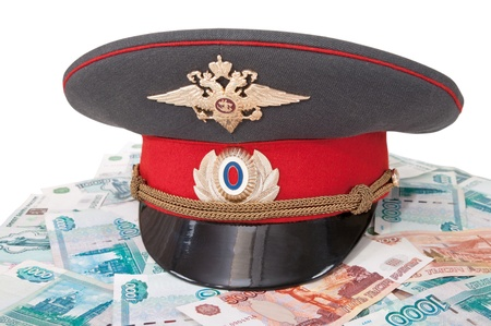 Police cap and money on white background Stock Photo - 9807868