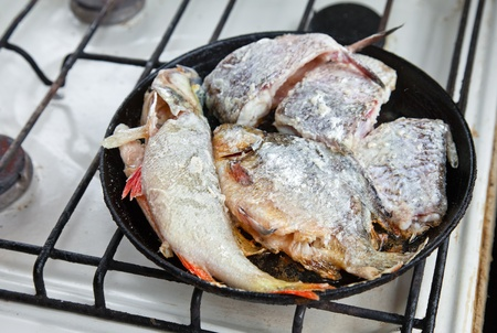 Fried fish in a frying pan Stock Photo - 10574054