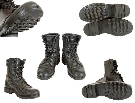 Old black army boots on white background Stock Photo - 10749245