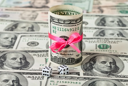 Two dices on money background - business concept Stock Photo - 10749251