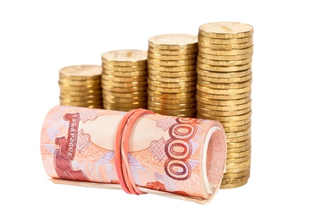 Russian rubles banknotes and coins over white