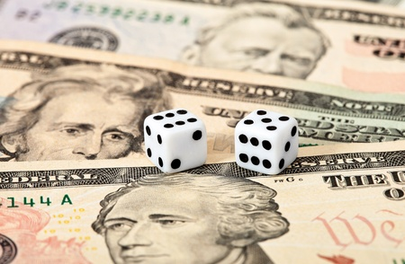 Dices on money background - business concept Stock Photo - 10817474