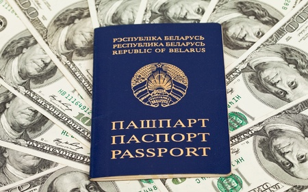Belarusian passport on US dollars background Stock Photo - 11129553