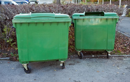 Two green recycling containers