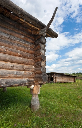 Ancient traditional russian wooden house X century, fragment. photo