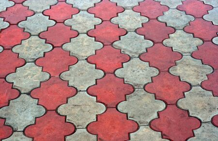 pave: Red and grey paving tiles