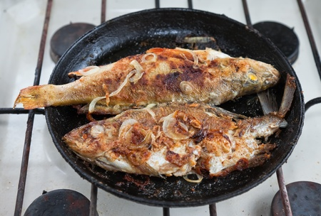 Fried fish in a frying pan Stock Photo - 12514723
