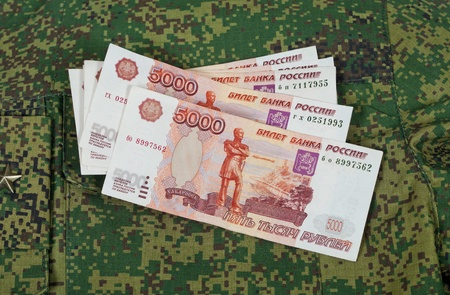 Banknotes on the military uniform   photo