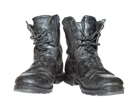 combat boots: Old army boots isolated on white background