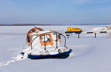 Hovercraft on the bank of a frozen river Stock Photo - 12514804