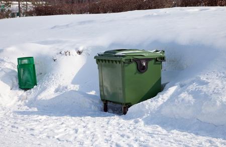 dumpster: Green dumpster in the winter park