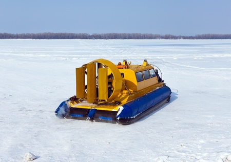 hovercraft: Hovercraft on the bank of a frozen river