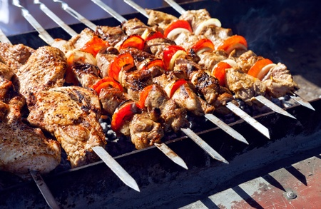 Juicy slices of meat with sauce prepare on fire  shish kebab   Stock Photo