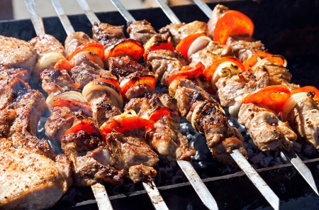 Appetizing fresh meat shish kebab  shashlik  prepared on a grill wood coal, outdor