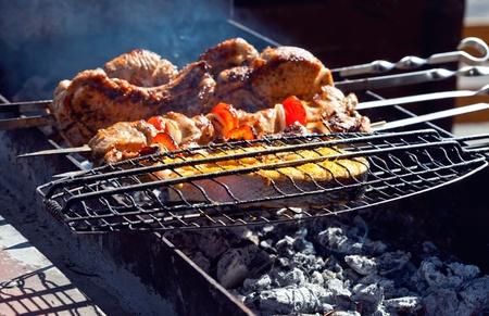 Appetizing fresh meat shish kebab  shashlik  prepared on a grill wood coal, outdor photo